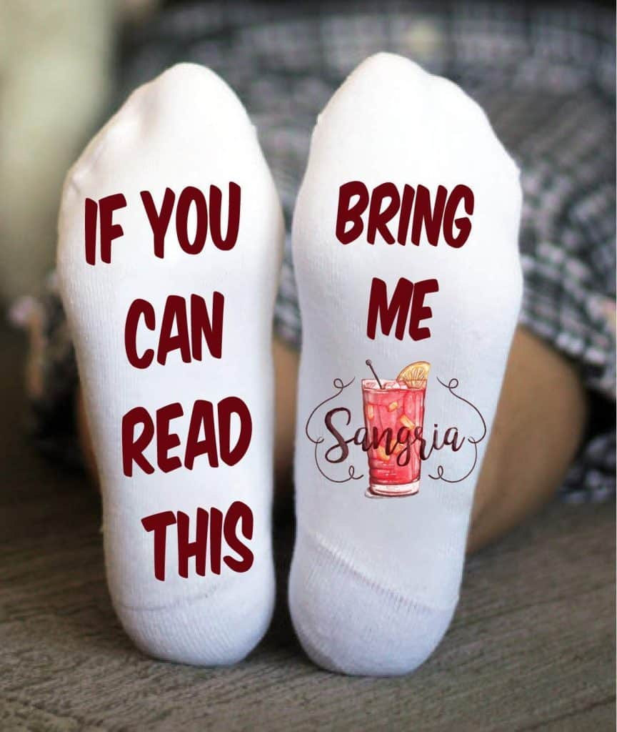"""white socks that read """"if you can read this bring me sangria"""" on the bottom"""