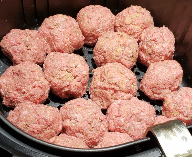 Meatballs ready to cook in the air fryer basket