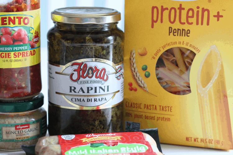 jarred rapini, penne pasta, hot pepper spread, minced garlic, Italian sausage