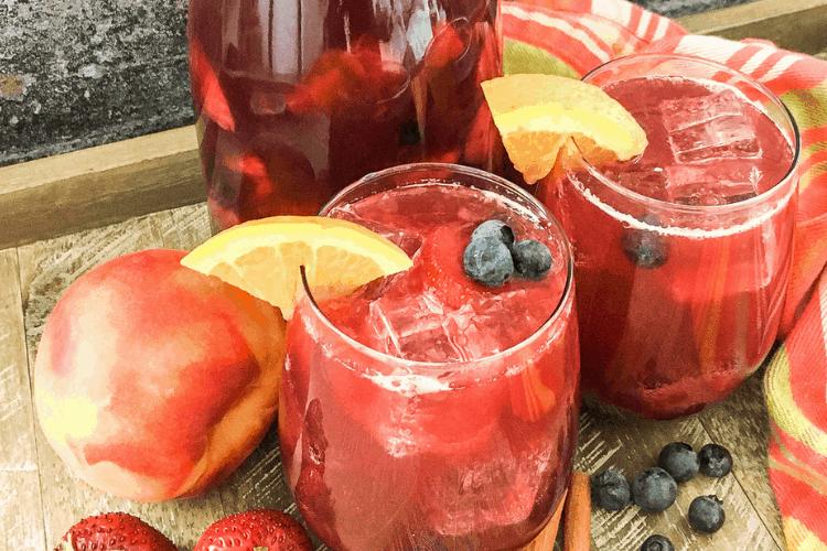 sweet peach sangria with berries