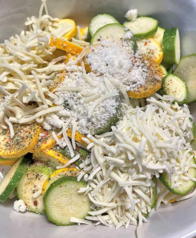 making cheesy zucchini casserole